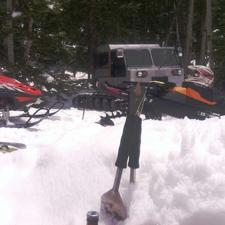 Sleds parked next to SnowCat