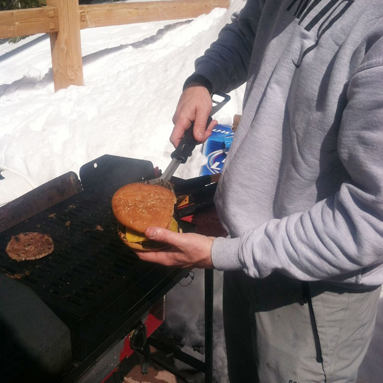 Serving burgers with spatula